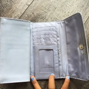 A baby blue wallet